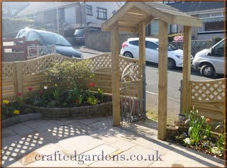 Wooden fence with arch garden features North Cornwall